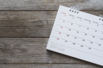calendar on a wooden background