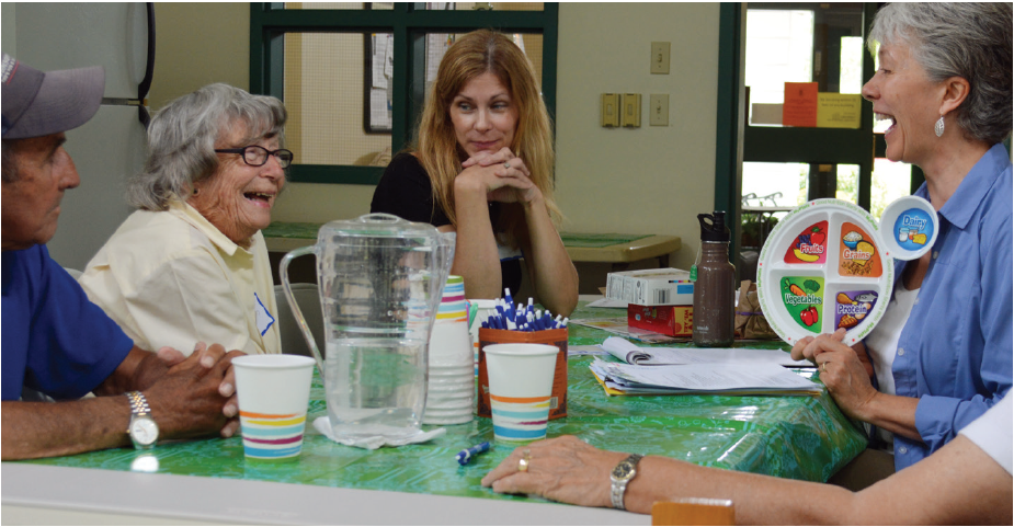 older adults talking to nutrition educator