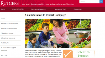 woman shopping with children in the produce section. select to protect logo in the corner