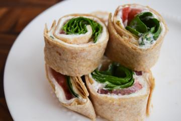 turkey pinwheels stacked on a plate