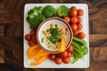 Vegetables on a plate with dip