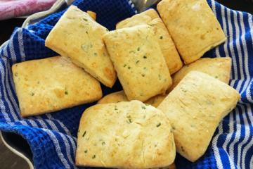 Chive Biscuits in a bowl with a towel
