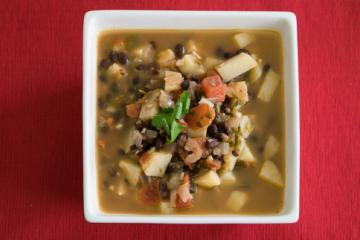 hearty mexican soup in a square white bowl