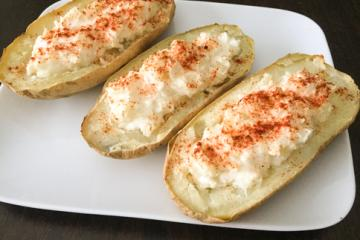 cheese stuffed potatoes on a plate
