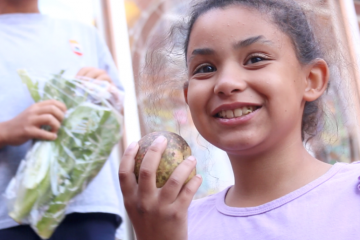 girl holds a turnip