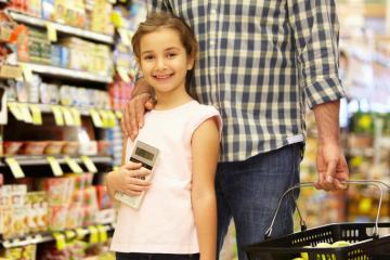 girl with calculator and father with shopping basket