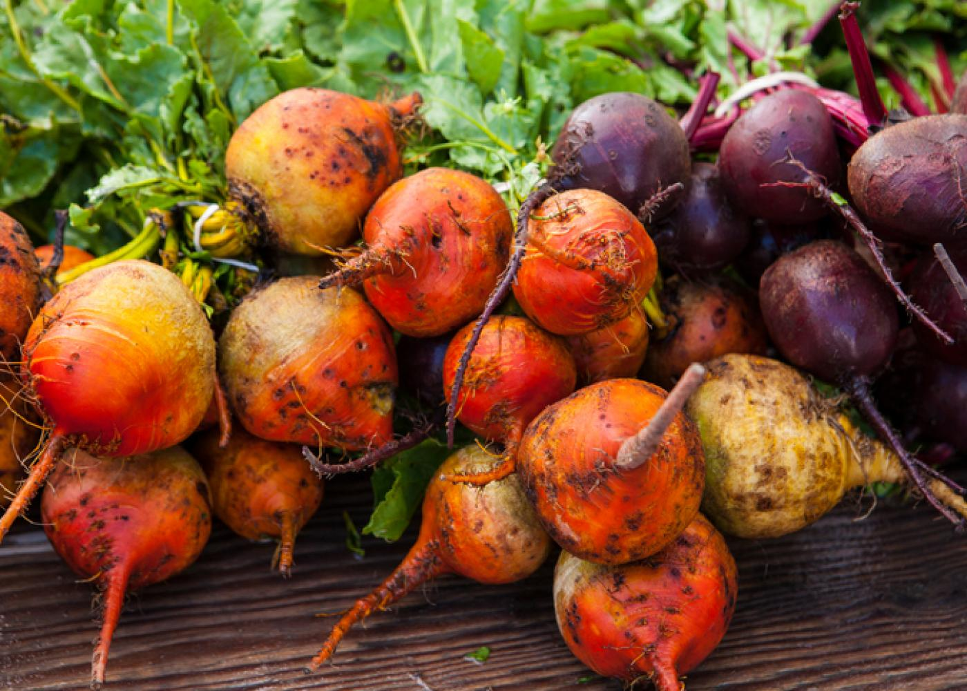 red and purple beets with green tops