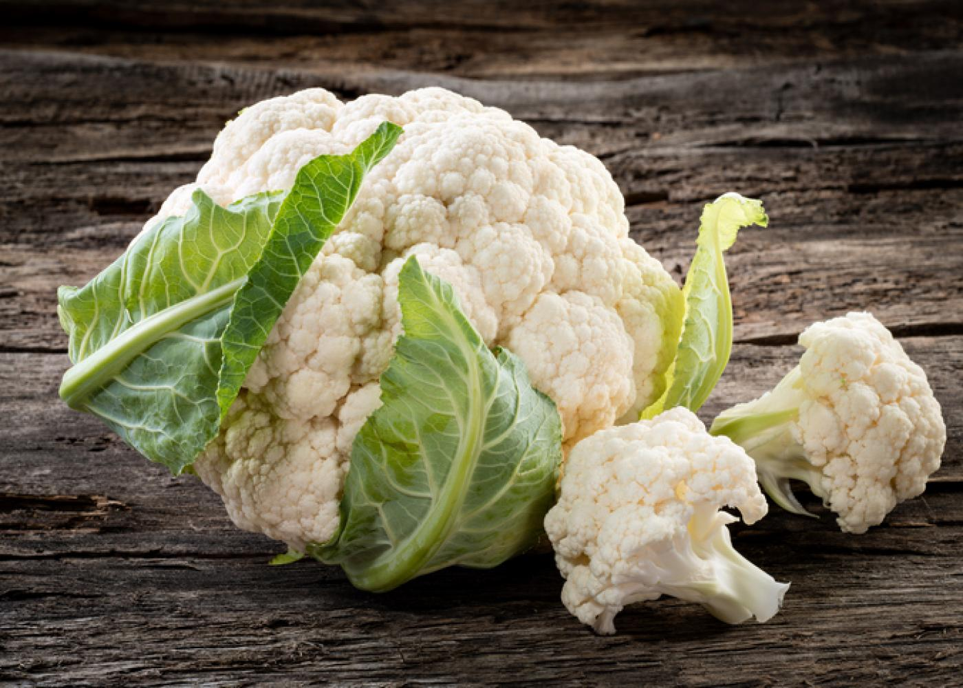 head of cauliflower with a couple of florets