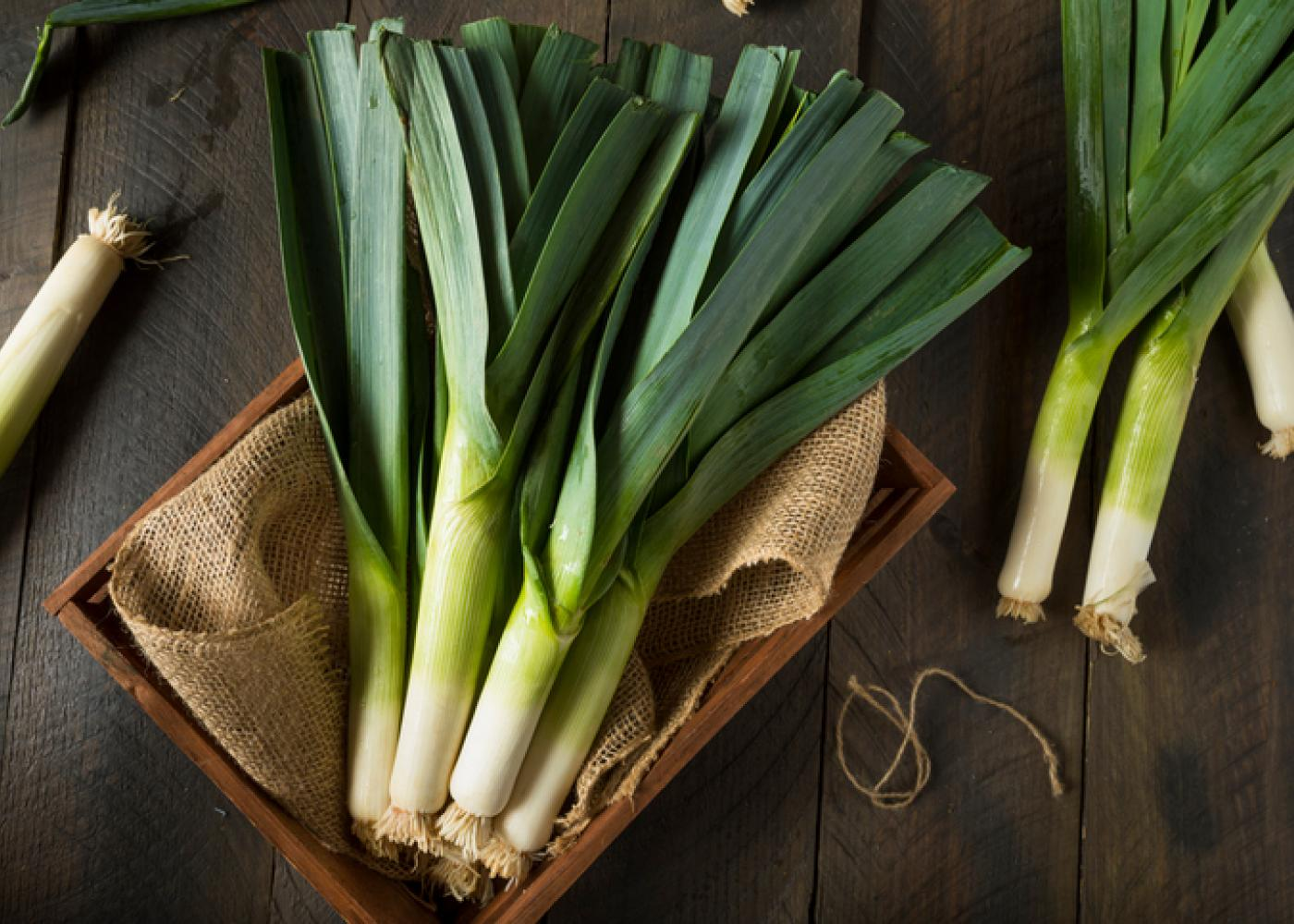 leeks on a wood table