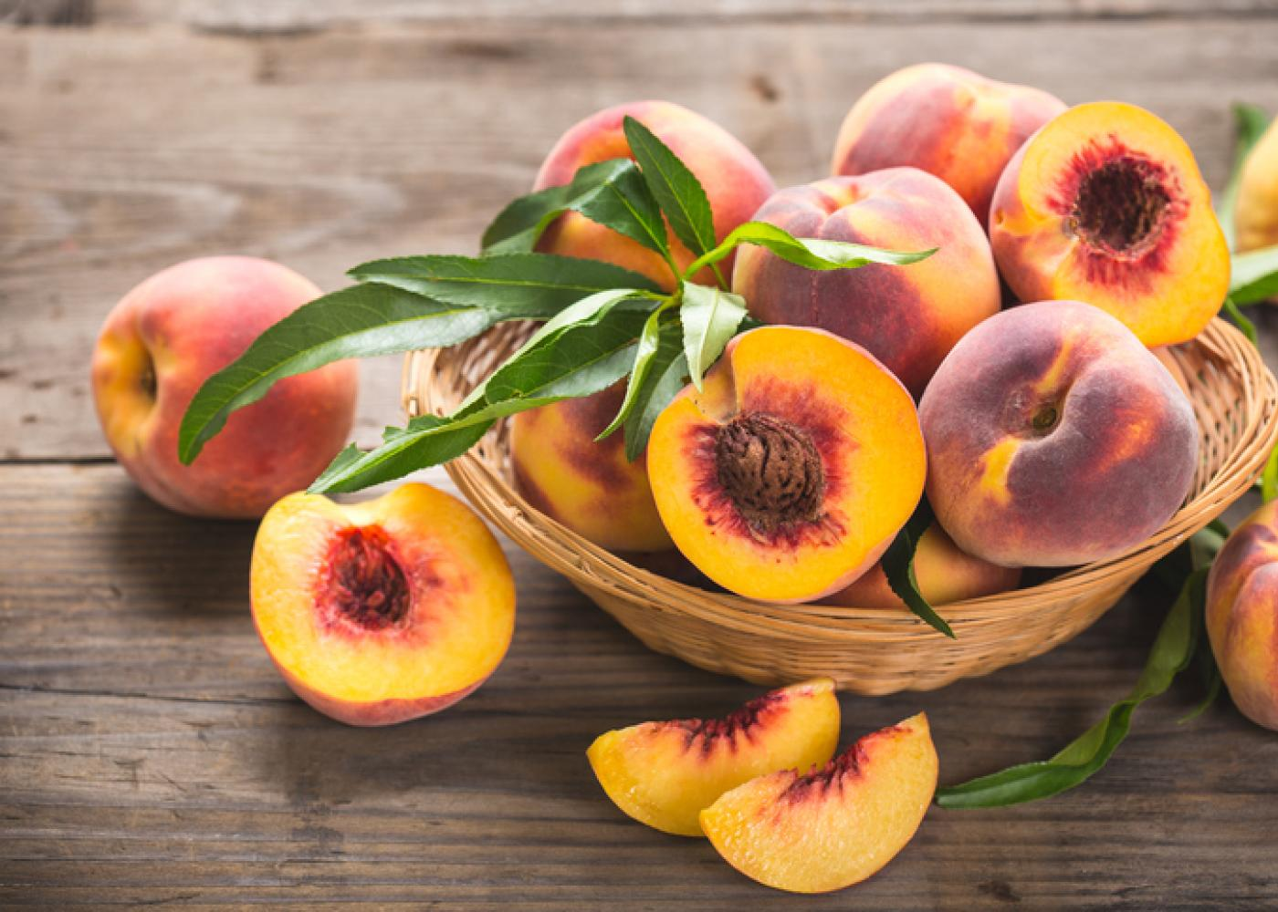 peaches with a wood background
