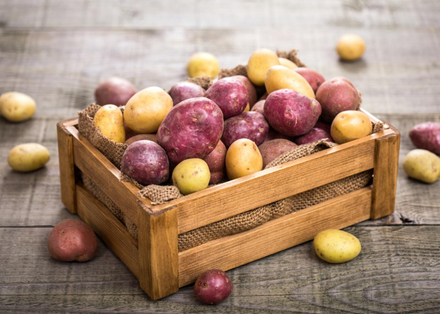 Red and white potatoes in a crate