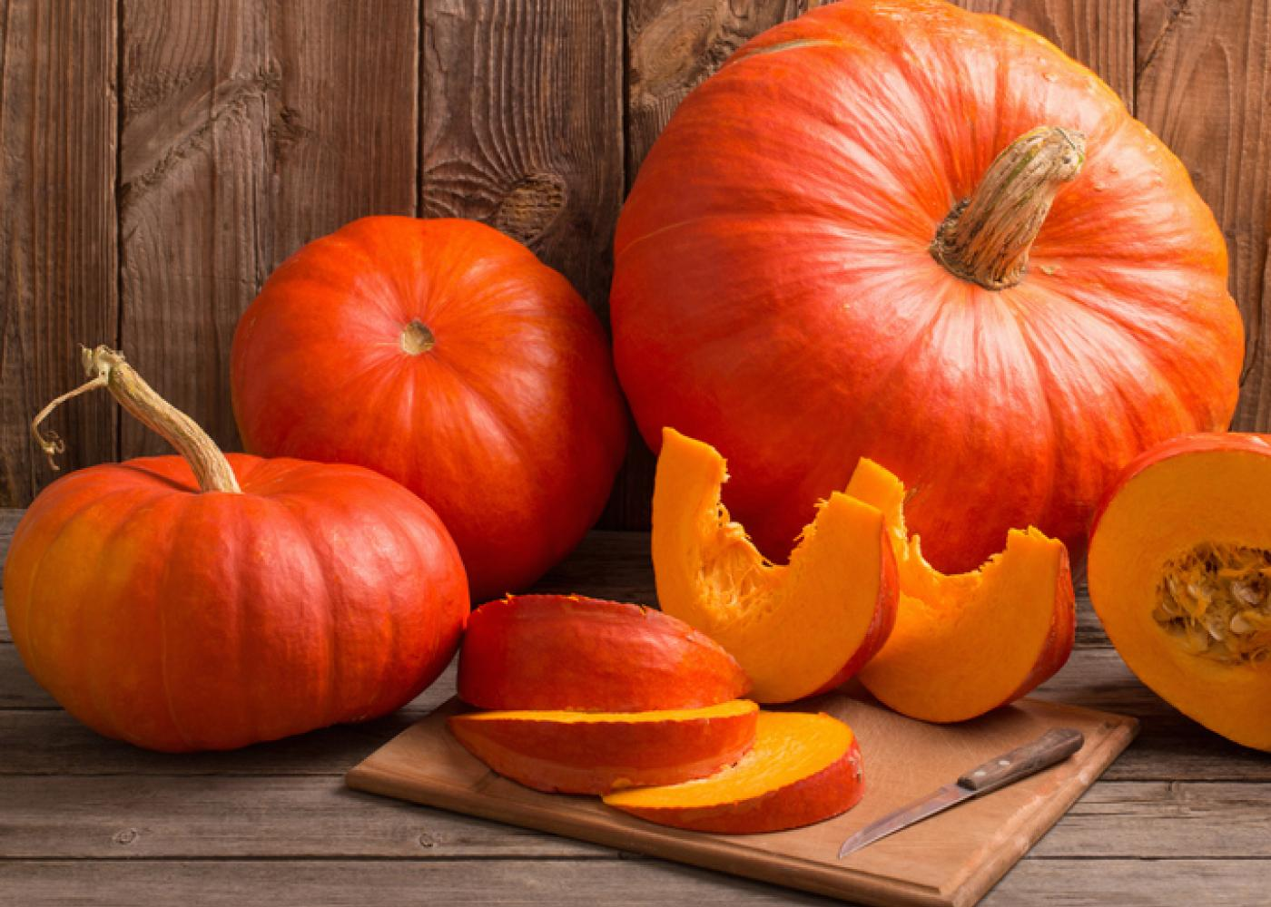 whole and sliced pumpkins