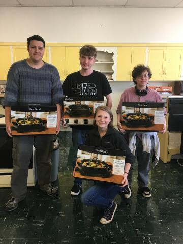 participants pose with their new electric skillets