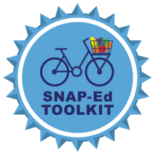SNAP-Ed Toolkit badge bicycle with fruits and vegetables in it