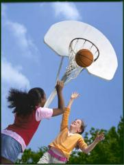 Two girls play basketball