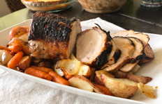 pork loin roast on a platter on a table