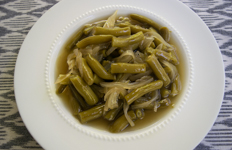 bowl of green beans with onions