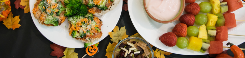 picture of Halloween menu items with a black background and fall leaves