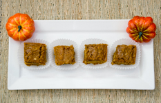 plate of pumpkin squares with pumpkin as decorations