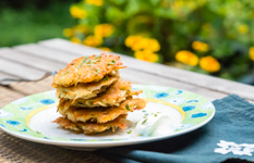 red lentil latkes stacked on a plate