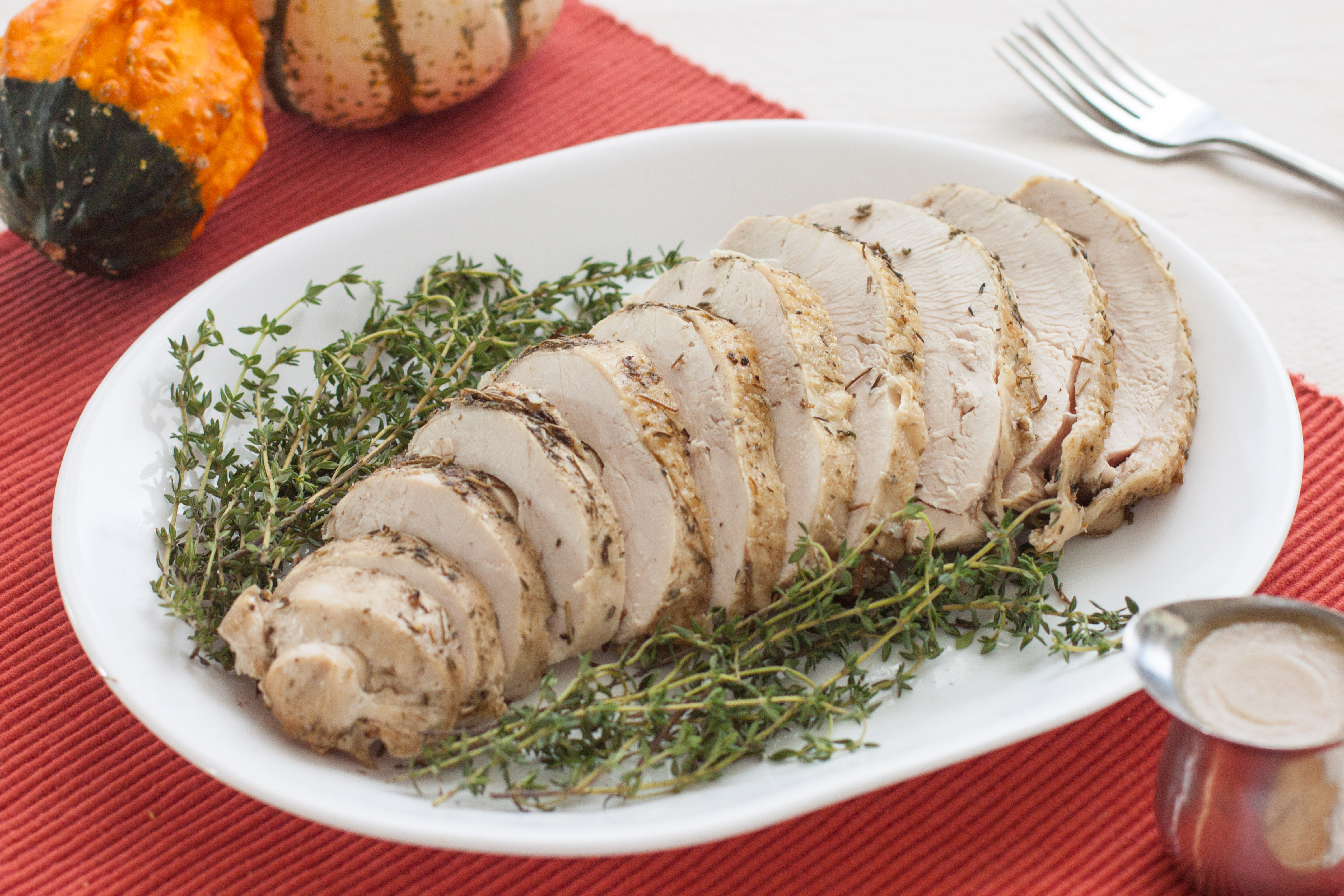roast turkey breast slices on a plate with garnish