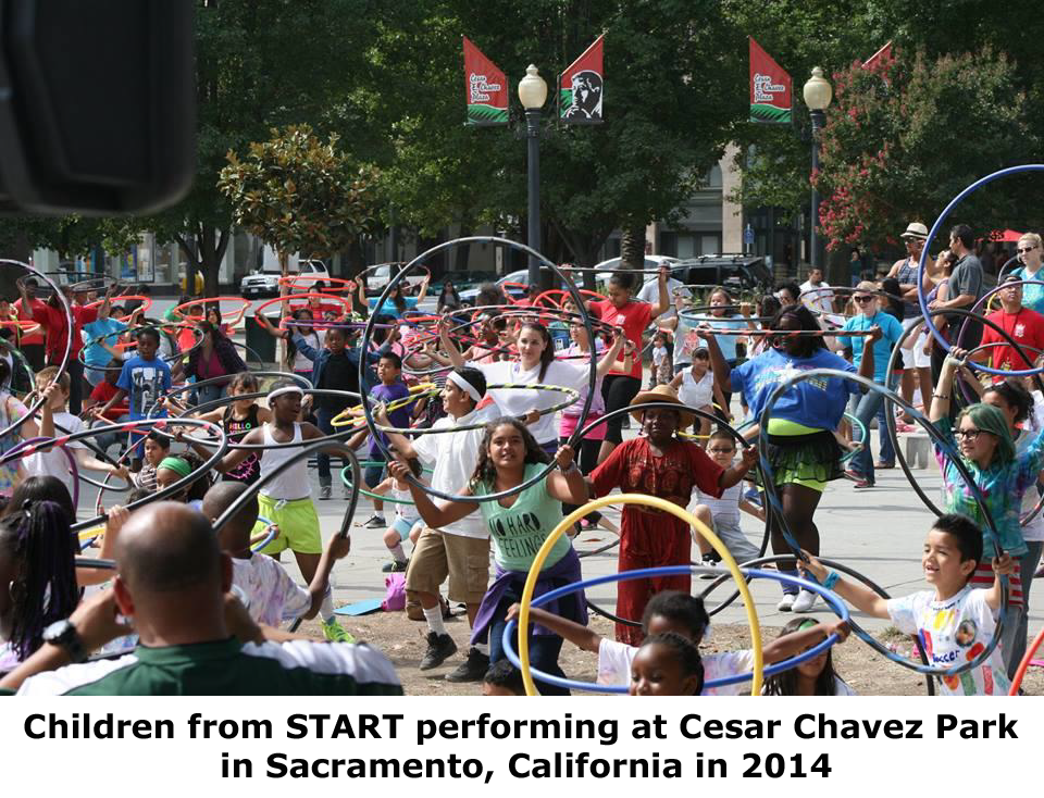 Photograph of children from START performing at Cesar Chavez Park in Sacramento, California in 2014