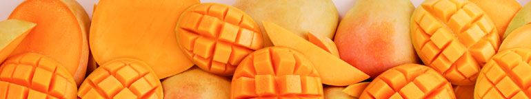 close up of cut and whole mangos