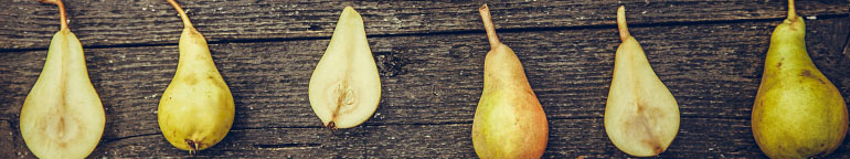 pears on a wood background