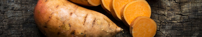 sweet potatoes on a wood background