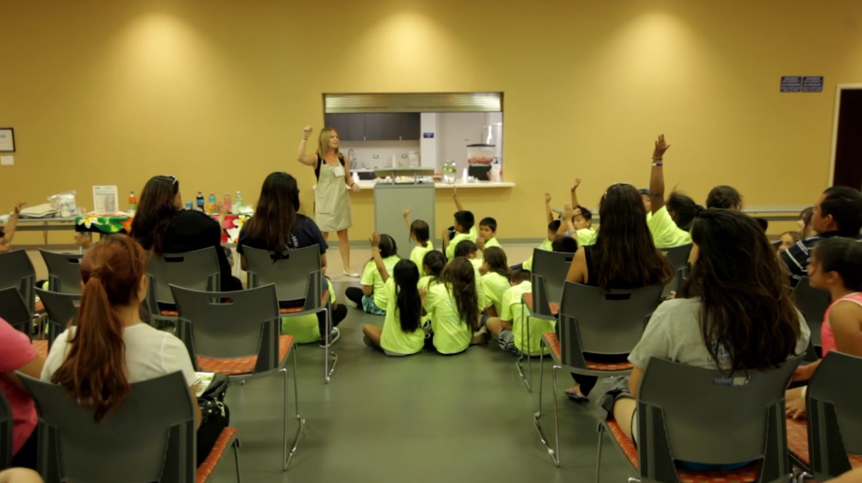 children watching a nutrition educator