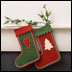 two stockings hanging on a mantle