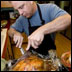 man carving a turkey